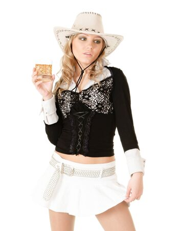 liquor girl: Young sexy woman in cowgirl dress with whiskey isolated on white background Stock Photo