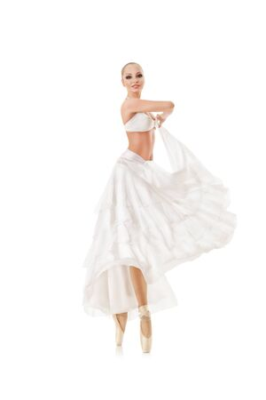 pointe: Smiling woman dancing classic ballet isolated over white background Stock Photo