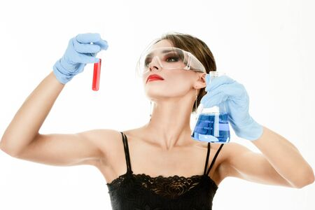 Young woman holding test tubes in hands during scientific experiment Stock Photo - 8596384