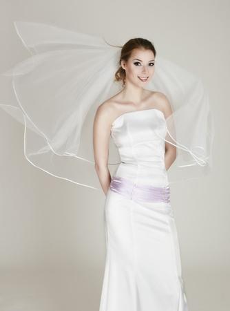 Emotional bride in white wedding dress photo