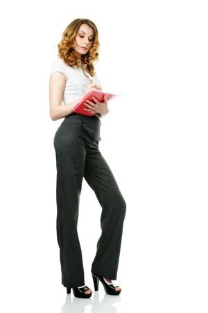 sidewards: Businesswoman listening and writing notes looking sidewards isolated on white background