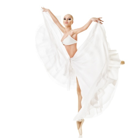 Smiling woman dancing classic ballet isolated over white background photo