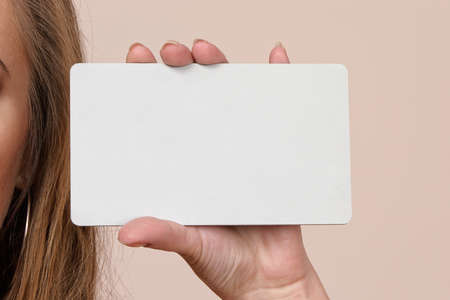 businesscard: Woman holding gray empty businesscard
