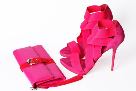 clutch: Fashionable pink high-heeled shoes isolated over white background