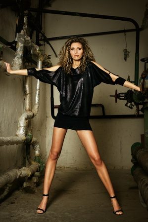 Fragile fashion model at dirty grunge water supply room Stock Photo - 8703303