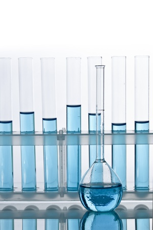 Laboratory glassware test tubes and vial with blue liquid photo