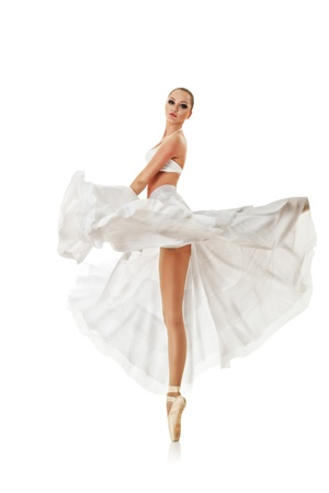 seductive: Smiling woman dancing classic ballet isolated over white background Stock Photo