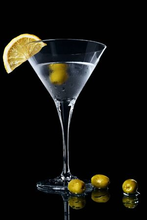 vermouth: Vermouth cocktail inside martini glass over dark background