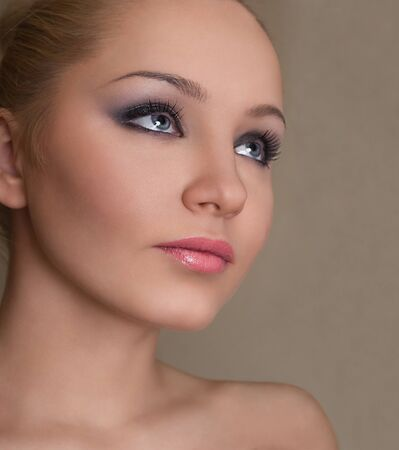 sidewards: Young attractive woman portrait looking sidewards and up Stock Photo