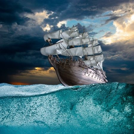 retro sunrise: Sail ship in storm sea against heavy sunset clouds Stock Photo