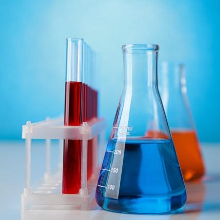 laboratory labware: Abstract laboratory glassware equipment over blue background Stock Photo