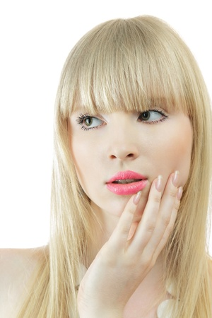 sidewards: Young woman touchink skin on cheek looking sidewards