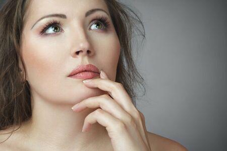 Beautiful young woman touching lips portrait Stock Photo - 9552700