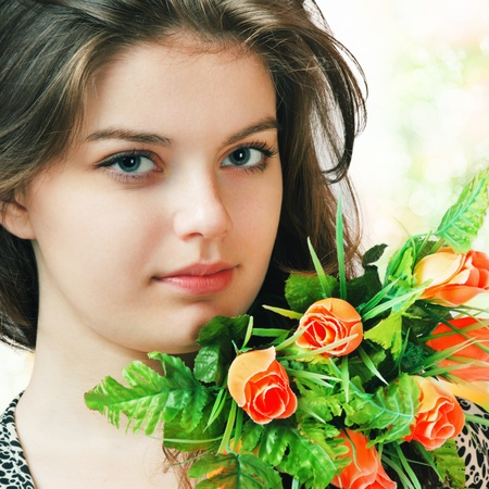 Young woman face with flowers bouquet Stock Photo - 9623372