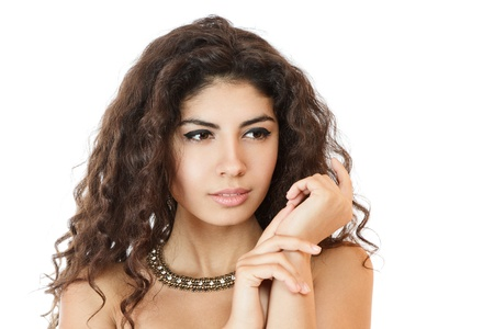 sidewards: Stunning young woman looking sidewards portrait with hands near face