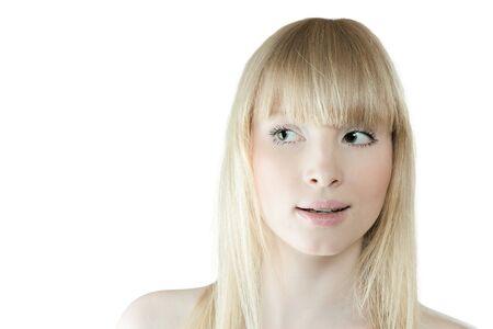 sidewards: Surprised young blond woman looking sidewards