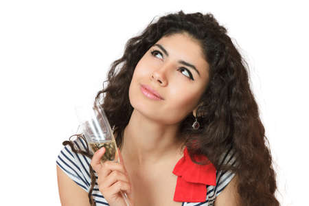 sidewards: Dreaming young woman with champagne looking up and sidewards Stock Photo