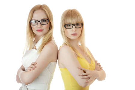 Two businesswomen standing together back to back isolated over white background photo
