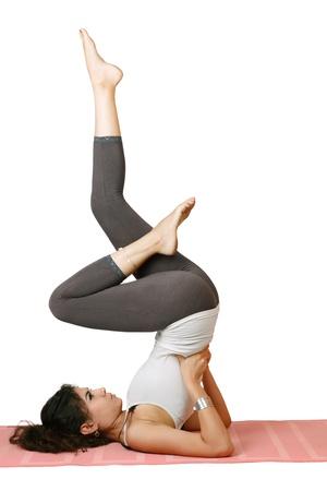 Young beautiful slim woman doing yoga