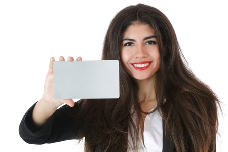 businesscard: Beautiful young businesswoman holding businesscard studio shot