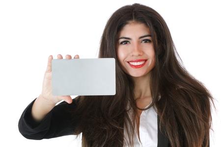 businesscard: Beautiful young businesswoman holding businesscard studio shot