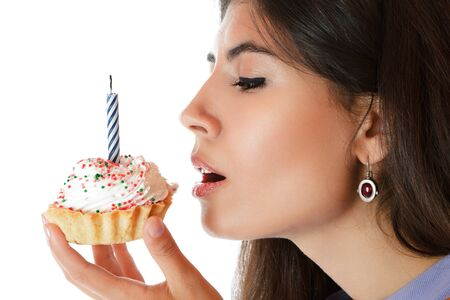 sidewards: Beautiful young woman with birthday cake isolated over white background Stock Photo