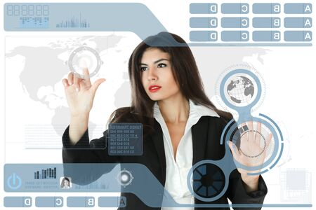futuristic woman: Young serious businesswoman working on modern touch screen
