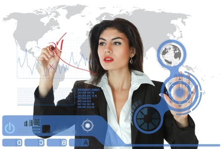 Young serious businesswoman working on modern touch screen Stock Photo - 9883435