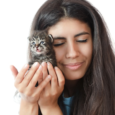 Young woman gently holding a small kitten photo