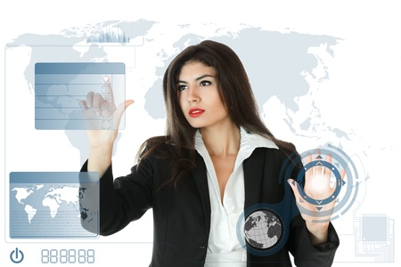 futuristic girl: Young serious businesswoman working on modern touch screen