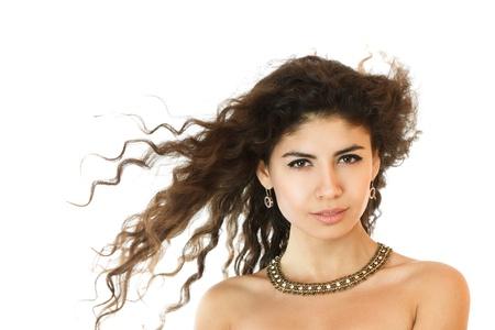 wild hair: Bella giovane donna con i capelli selvaggi girato in studio Archivio Fotografico