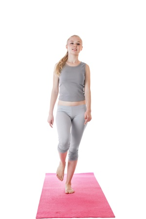 girl walks on the gymnastic mat during training Stock Photo - 10368124