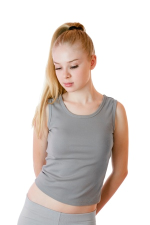 Young slender woman in training gray clothes isolated over white background Stock Photo - 10419780