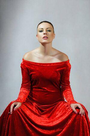 velvet dress: Young woman in gorgeous red velvet dress