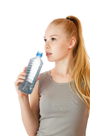 slender woman: Young slender woman with plastic water bottle isolated over white background Stock Photo
