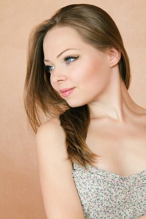 sidewards: Beautiful young smiling woman looking sidewards Stock Photo