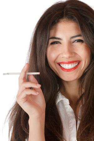 persona fumando: Joven empresaria fumando un cigarrillo delgado con placer
