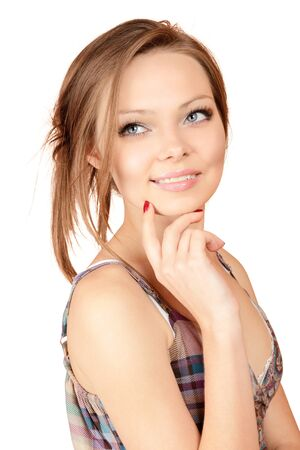 sidewards: Young beautiful smiling woman portrait looking sidewards touching chin