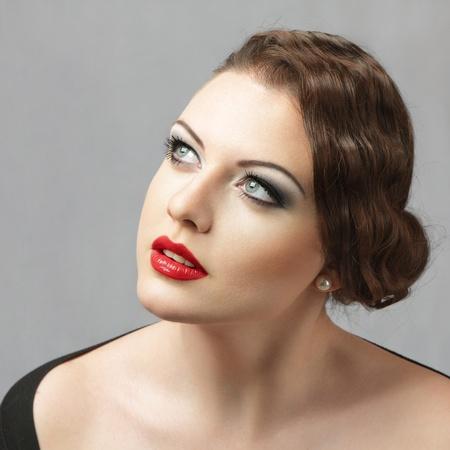 female portrait: Retro style portrait of young elegant woman