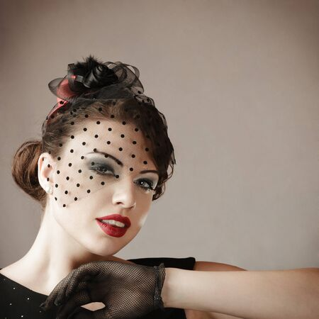 cool girl: Retro style studio portrait of young beautiful woman Stock Photo