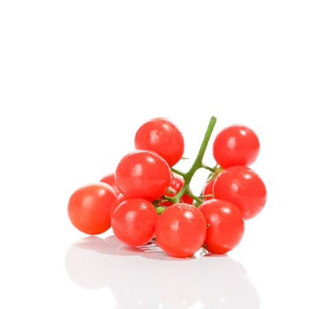 ripeness: Cherry tomatoes isolated over white background