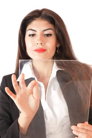 Young serious businesswoman working on modern touch screen photo