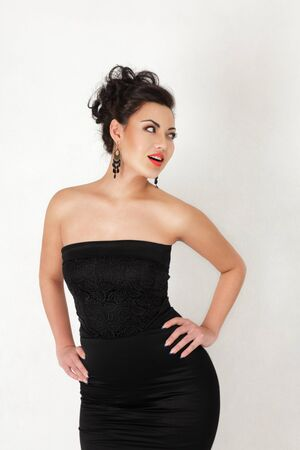 sidewards: Beautiful young asian woman looking sidewards studio shot Stock Photo