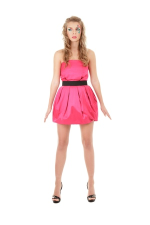 Fashion model in pink mini dress posing like doll Stock Photo - 11498373