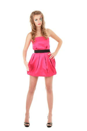 Fashion model in pink mini dress posing like doll Stock Photo - 11498376