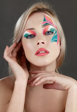 Beautiful young blonde woman with fantasy flowers creative make-up studio shot Stock Photo - 11498418