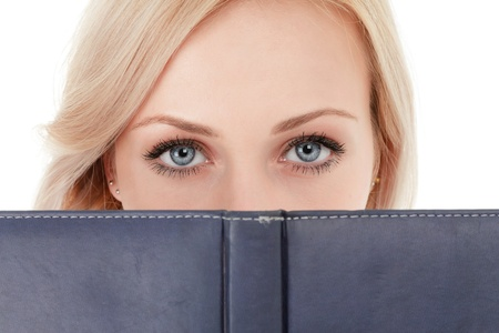 Closeup of woman face behind book cover Stock Photo - 11498411