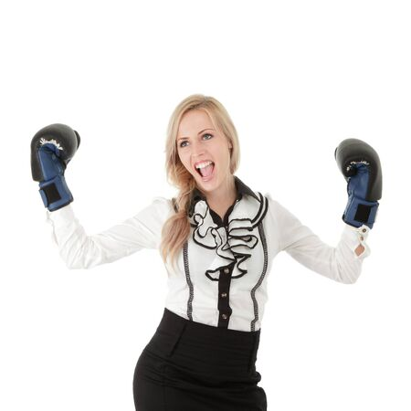 Young blonde businesswoman with boxing gloves isolated on white background photo