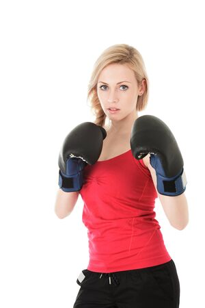 Young blonde woman with boxing gloves isolated on white background 版權商用圖片
