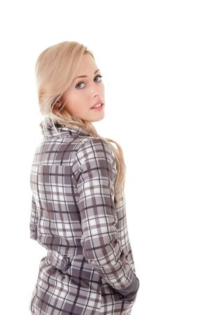 looking over shoulder: Beautiful young blond woman in coat isolated over white Stock Photo